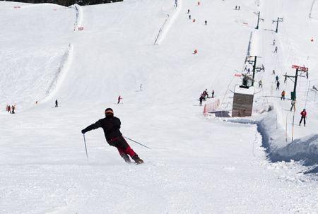 Man skiing down the hill, La Masella, Gerona, Spain. photo