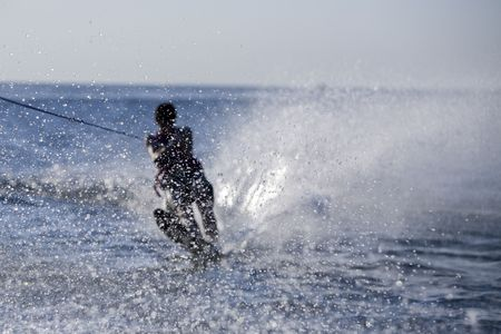 Teenager water skiing Stock Photo