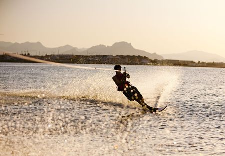 Teenager water skiing at sinset, Denia, Spain Stock Photo