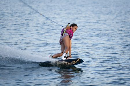 Female teenager wake boarding