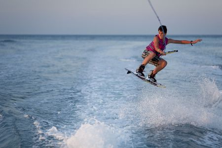 water skiing: Teenager wake boarding. Stock Photo