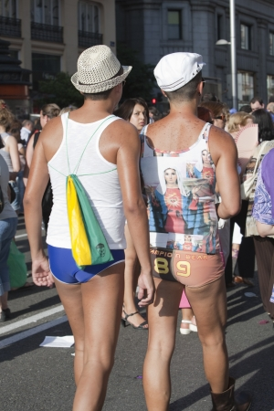 July 3rd, 2010, Madrid.  Gay Pride. Couple of adult men parading along Gran V�a, celebrating Gay Pride, Madrid, Spain.