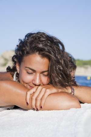 Pretty young latin woman, relaxed sunbathing on boat. Stock Photo - 7908225