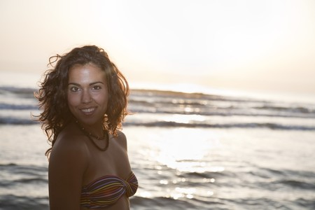 adriana: Portrait of young pretty woman by the beach.