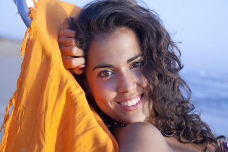 Pretty young latin woman, relaxed sunbathing at the beach. Stock Photo - 7908274