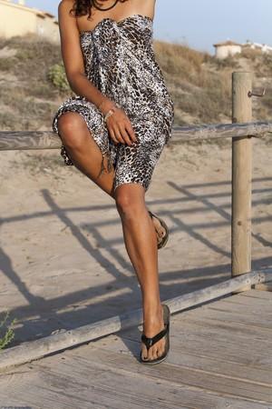 sarong: Young pretty woman wearing sarong looking sideway.