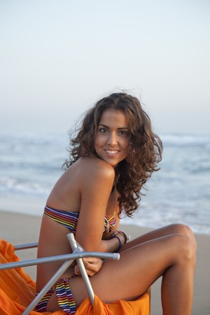 Young pretty woman dressed with stripped bikini,  at the beach of Valencia , Spain. Stock Photo - 7908276