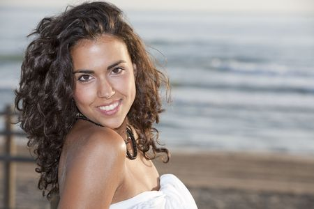 Young pretty woman wearing white sarong by the beach. Stock Photo - 8088932
