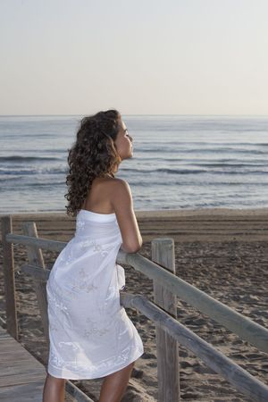 Young pretty woman wearing white sarong by the beach. Stock Photo - 8088928