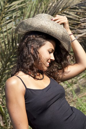 Young pretty Latin Looking woman wearing black t-shirt by the countryside. Stock Photo - 7969575