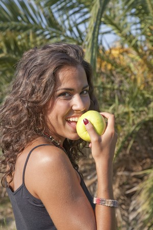Young pretty woman eating an apple. photo