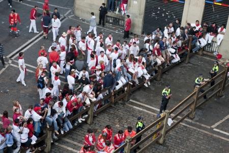 policewomen: San Fermin festivities.. People getting ready for the bull, Pamplona, Spain
