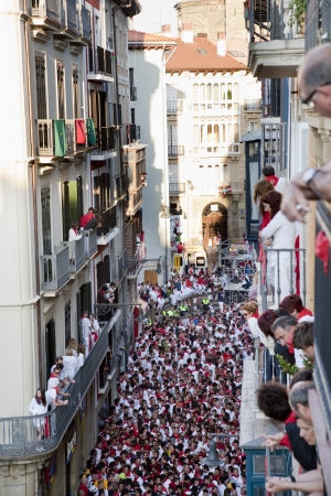 basque woman: San Fermin festivities. People getting ready for the bull;Pamplona, Spain Editorial