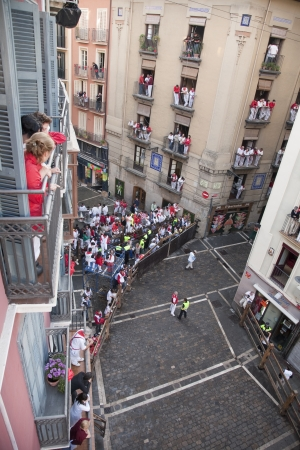 policewomen: San Fermin festivities. People getting ready for the bull;Pamplona, Navarra, Spain.