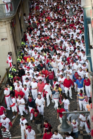 bull fight: San Fermin festivities.Pamplona, Navarra, Spain. People getting ready for the bull