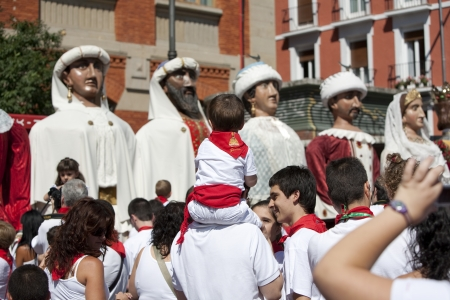 street shots: San Fermin festivities. People taking pictures to Giants and Large Heads Parade.