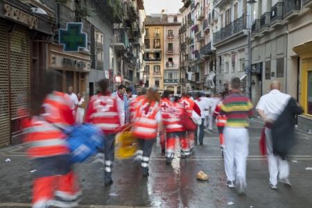bull fight: San Fermin festivities. Nurses running to help to an injured in San Fermin, Pamplona, Spain. Editorial