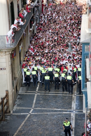 San Fermin festivities. Police containing to the runners before the running of the bulls, Pamplona, Navarra, Spain. Stock Photo - 14667819