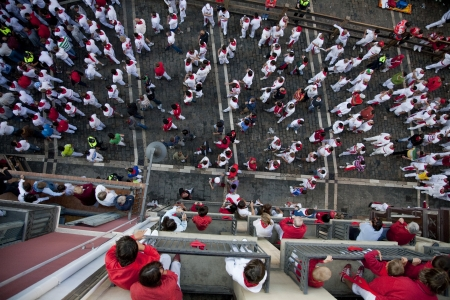 places of interest: Runners looking for their best place, before the running of the bulls. Pamplona, Navarra, Spain.