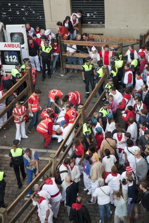 Public health attending to an injured during the running of the bulls. Pamplona, Navarra, Spain