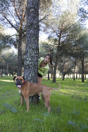 Young girl with her dog in a park. photo