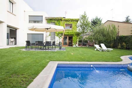 Partial view of a semidetached house from the garden and swimming pool. Stock Photo - 9327288