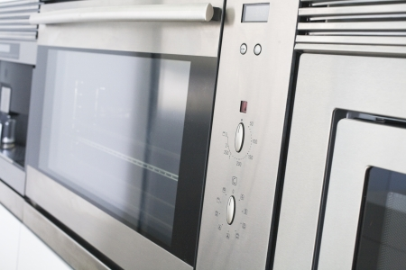 Modern double oven made of stainless steel.