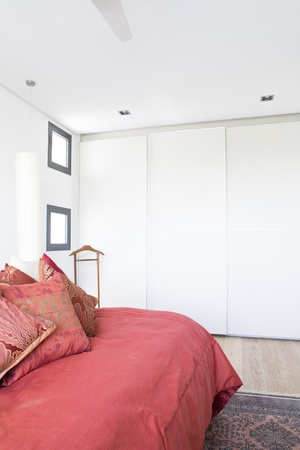 bedchamber: Main Bedroom with built-in wardrobe with sliding doors. Stock Photo