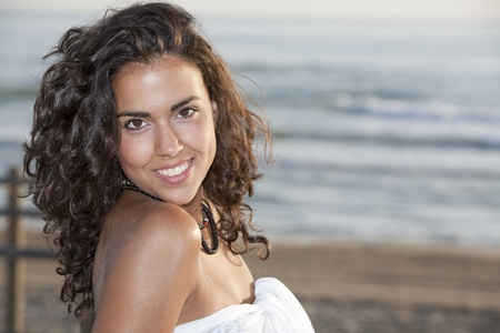 Young pretty woman wearing white sarong by the beach. Stock Photo - 9371775