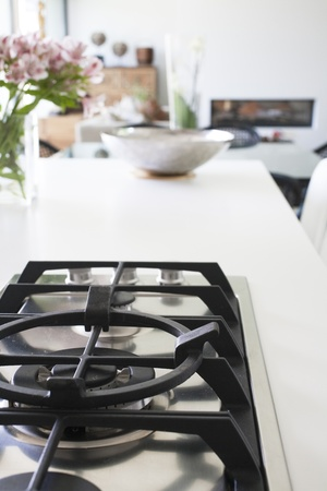 countertop: Partial view of kitchen counter and gas stove of modern home. Stock Photo