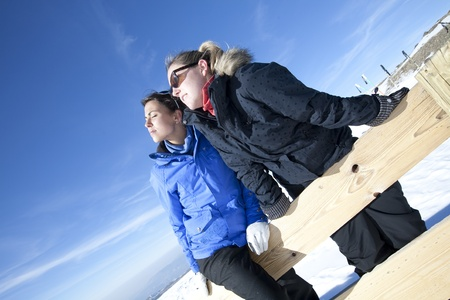 Two young girlfriends relaxed at a ski resort Stock Photo - 9371776