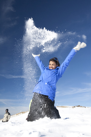 Young girls throwing snow Stock Photo - 9371773