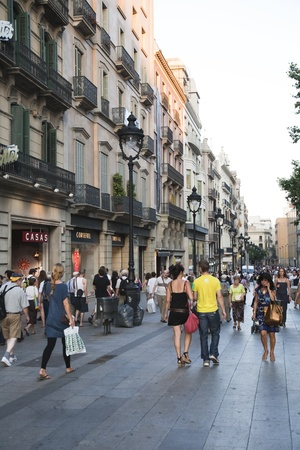 July 2010, Barcelona. Pedestrians walking down Gran Via, one of the most popular shopping streets of Barcelona, Spain.