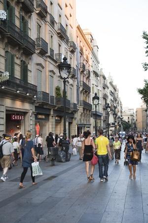 gran via: July 2010, Barcelona. Pedestrians walking down Gran Via, one of the most popular shopping streets of Barcelona, Spain. Editorial