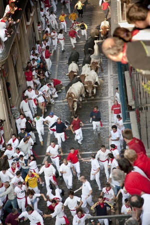 July 8th, 2009, Pamplona. Running of the bulls during  Saint Fermin celebrations. Pamplona, Navarra, Spain. One of the most popular local holidays in Spain.