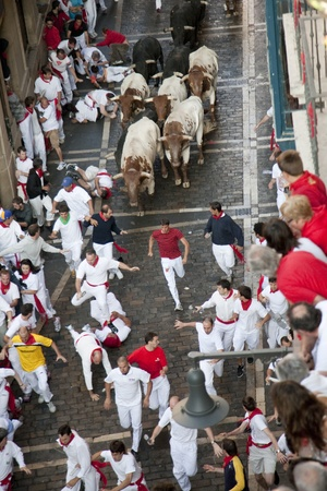 tourada: July 8th, 2009, Pamplona. Running of the bulls during  Saint Fermin celebrations. Pamplona, Navarra, Spain. One of the most popular local holidays in Spain.