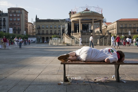 July 8th, 2009, Pamplona. Man sleeping totally drunk on the street after a long night of celebrations of Saint Fermin celebrations. Pamplona, Navarra, Spain. One of the most popular local holidays in Spain. Millions of people from all over the world come. Stock Photo - 9638148