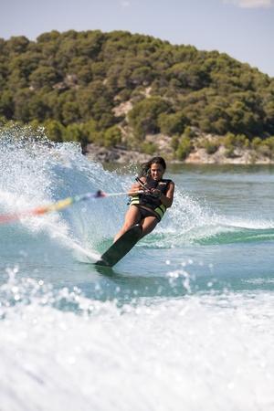 Teenager girl water skiing in lake. Stock Photo - 9638619