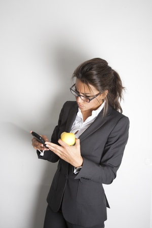 Young pretty female business executive reading worrying message on her smartphone Stock Photo - 9638598