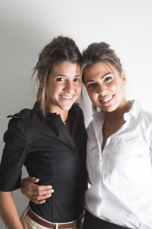 Portrait of two young female business executives  photo