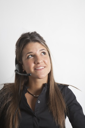 Portrait of young telephone operator, looking sideways. photo