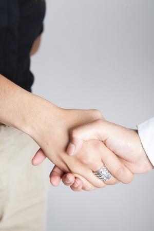 Two women shacking hands. photo