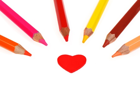 Colorful pencils and heart isolated on white photo