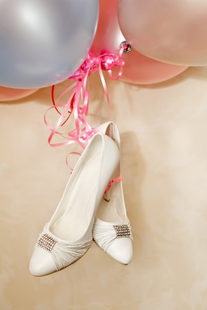 Bride shoes and balloons photo