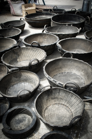 subsistence: Farm receptacles made of old tyres on sale at Saquisili market, Ecuador