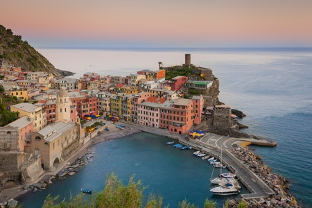 vernazza: The colorful village of Vernazza after sunset  Cinque Terre, Italy Stock Photo