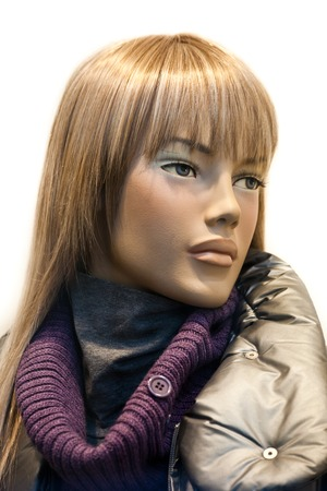 manequin: A close up of a mannequin with modern Italian style clothing in a shop window Stock Photo