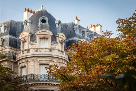 sun roof: View of a Parisian building with mansard roof