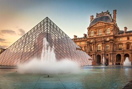 View of the Louvre Museum and the Pyramid at sunset