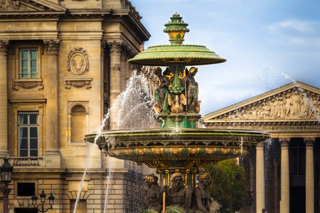 madeleine: Fountaine de Fleuves in Place de la Concorde, Paris  The Madeleine church in the background